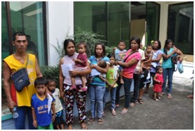 Patients wait to see a physician the Filipino clinic.